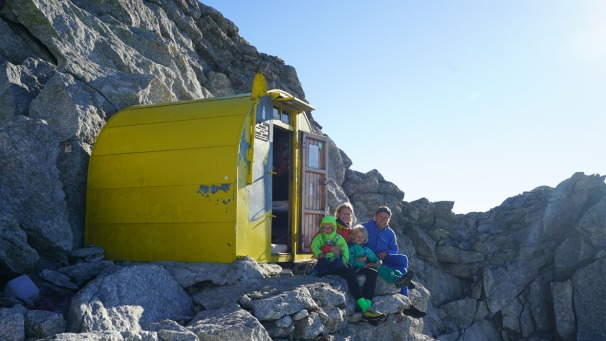 PIC 1. The Houlding family in the bivouac hut near the summit of Piz Badile